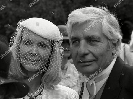 West German playboy Gunter Sachs and his wife Mirja Larsson, are pictured during the wedding celebration of Leopold von Bismarck, who married model Debonnaire Patterson, near Oxford, England