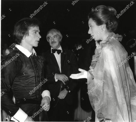 """Britain's Princess Anne gestures as she talks with Russian born dancer, actor and choreographer, Rudolf Nureyev, after his following a silver Jubilee Gala for Queen Elizabeth II, at the Royal Opera House, Covent Garden, London, England, . Nureyev and his partner Dame Margret Fonteyn danced a specially created one-act ballet of """"Hamlet"""" for the Queen"""