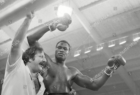 Heavyweight boxing champ Larry Holmes is embraced by his manager Richie Giachetti after he stopped challenger Earnie Shavers in the 11th round of their title fight on in Las Vegas