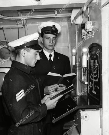 Stock Photo of A specially built-in synagogue is part of the standard equipment of Israel warships on . Shown here at prayers aboard the frigate Misgav are Joseph Blumenorans (left) who was born in Poland, and Reuben Sadnai, born in Israel