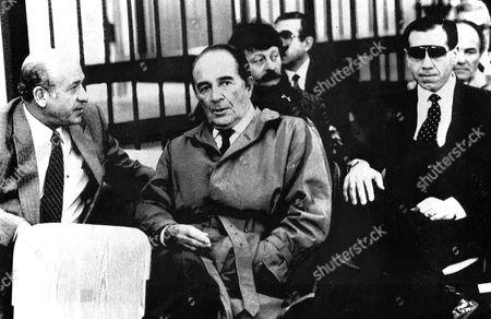 Stock Photo of Italian actor Rossano Brazzi (center) during trial, in Venice