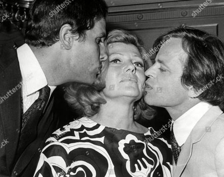 GIULIANO GEMMA; RITA HAYWORTH; KLAUS KINSKI Italian actor Guiliano Gemma, left, and austrian born actor Klaus Kinski, kiss American actress Rita Hayworth during a cocktail party in a fashionable hotel in Rome, Italy, to introduce the stars of a new film 'I Bastadi' (The Bastards) to the press. The movie will be directed by Italian Duccio Tessari, with the three artists in the leading roles, together with French actress Claudine Auger and Italian actresses Lorella De Luca and Bedy Moratti