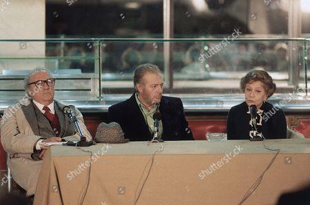 "Italian director Federico Fellini, left, his wife Giulietta Masina and Italian actor Marcello Mastroianni at a press conference on Fellini's new movie ""Fred and Ginger"" on in Rome, Italy"