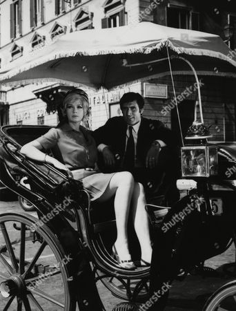 """1969 image of Hungarian actress Terry Torday and her Italian partner Lando Buzzanca, as sit in a horse drawn coach in Rome, Italy, on a sight seeing tour. The two are producing the West German comedy """"Warum habe ich bloß 2 mal Ja gesagt"""" (Why Only Did I Say Yes Twice"""