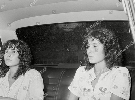 Stock Image of Martine Zacher German twin sister Martine, left, and Marie Zacher leave police station by car in Rome, after handing police a letter reportedly asking ransom for Paul Getty III, the nephew of American billionaire Paul Getty, who disappeared from home a week ago