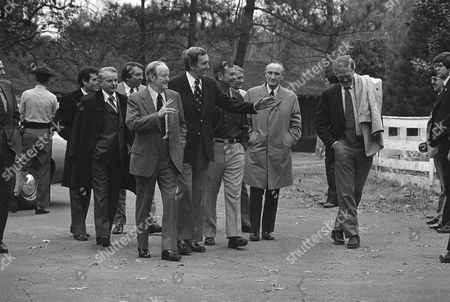 Stock Picture of Members of President-elect Jimmy Carter's staff and U.S. Senators arrive at Se. Herman Talmadge's farm near Lovejoy, GA, to meet with Carter, . Pictured left to right: Jack Watson, Sen. Robert Byrd, Frank Moore, Sen. Hubert Humphrey, Sen. Ed Musky, Sen. Herman Talmadge, Jody Powell, Sen. Mike Mansfield