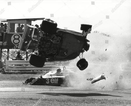 Gilles Villeneuve, Ronnie Peterson Ferrari 312 T2 driven by Gilles Villeneuve of Canada flies in the air over Swedish driver Ronnie Peterson's Tyrrell P34 moment after the two cars collided, during the Japan Grand Prix on the 4.3 kilometer course of Fuji International Speedway near Gotemba, south of Tokyo. The cars plunged into a spectator area and killed at least one person, injuring other people seriously but drivers of the two cars escaped injury