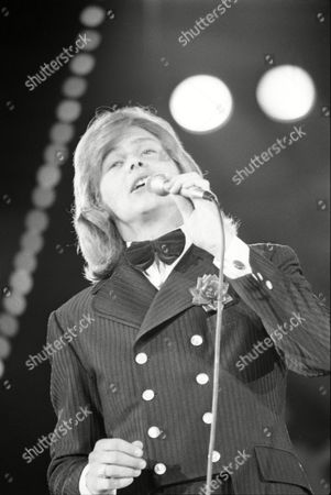 """Johnny Farnham; John Farnham Australian singer Johnny Farnham sings """"Don't You Know It's Magic"""", in preliminary judging of the three-day """"World Popular Song Festival"""", in Tokyo, Japan on . About 130 singers and musicians from 37 countries are participating in the festival"""