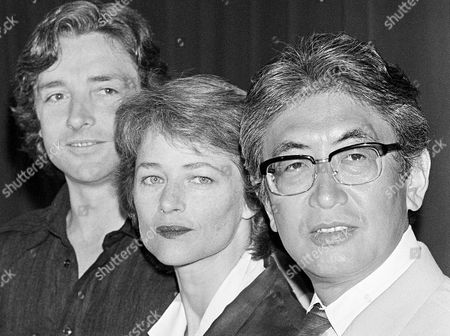 """Charlotte Rampling, Anthony Higgins, Nagisa Oshima Japanese film director Nagisa Oshima, right, who's film """"Max My Love"""" is in competition during the 39th Film Festival in Cannes, France, poses with British actress Charlotte Rampling, center, and British actor Anthony Higgins, left, at Cannes, France. Oshima, a Japanese director known for internationally acclaimed films """"Empire of Passion"""" and """"In the Realm of the Senses"""" has died of pneumonia. He was 80. His office says Oshima died Tuesday afternoon, Jan. 15, 2013, at a hospital near Tokyo"""