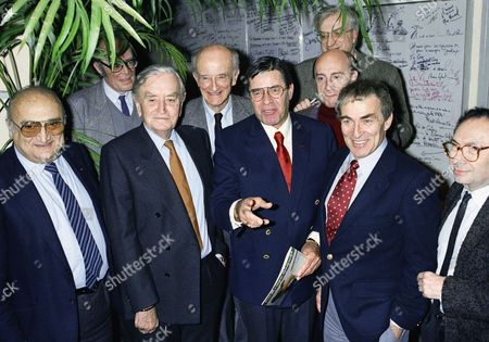 Stock Photo of French and American movie directors gather on in Paris as part of a meeting with the press to express their common protest against the advertising cuts as well as the black and white original films coloring. From left are, Henri Verneuil, David Lean, Fred Zinnemann, Jerry Lewis, Michel Blanc and Elliot Silverstein. Background upper right Bertrand Tavernier and background left unidentified