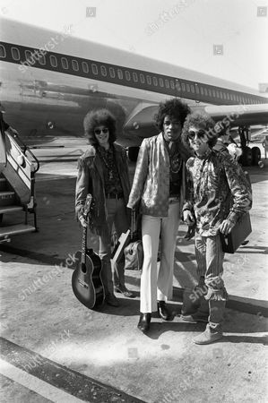Noel Redding, left, Jimi Hendrix, centre, and Mitch Mitchell, of the Jimi Hendrix Experience, arrive at Heathrow airport, London, after completing a nine week tour of the United States