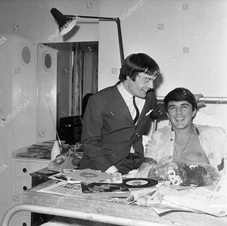 Jimmy Nicol visiting fellow drummer Dave Clark, who is resting in a Harley Street Nursing Home, in London, England, with a suspected duodenal ulcer, Jimmy is his replacement, for a season at Blackpool. He is no stranger for stand in engagements, having just completed a similar task for Ringo Starr, unseen, on the Beatles tour of Australia