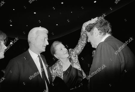 """U.S. star Joan Fontaine, chairwoman of the international jury for the """"Berlinale"""", puts her hand onto the head of Moritz De Hadeln, director of the """"Berlinale"""", to wish him good luck as the festival was opened on in Berlin. Berlin's governing Mayor Richard Von Weizsaecker (left) looks on the scene"""