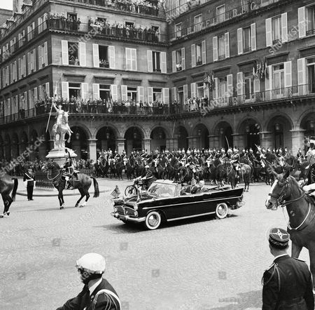 Presidents John Kennedy and Charles de Gaulle ride together in car along the Rue de Rivoli in Paris on en route from Orly Field to the Quai d'Orsay. Kennedy is in France for a three day state visit