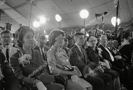 Stock Photo of Family of astronaut John Glenn, Jr., sits in the front row during his news conference at Cape Canaveral, Fla., . Left to right are Glenn's wife Annie, daughter Lyn and son David, parents John Herschel and Teresa Glenn, and Dr. H. W. Castor and Margaret Castor, parents of the astronaut's wife