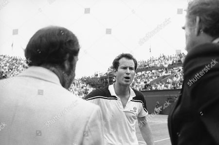 John McEnroe, Roger Smith John McEnroe of the United States exchanges heated words with umpire Roger Smith during the final of the Stella Artois Tennis championship at the Queen's Club in London on . In several minutes of heated conversation McEnroe refused to play on after the umpire reversed a line judge's call and demanded to see referee Jim Moore. During the argument McEnroe called the umpire a 'moron'. All finished well for McEnroe he won the championship beating fellow American Lief Shiras 6-1, 3-6, 6-2 to win the championship