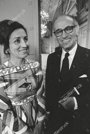 Stock Photo of Dr. Jonas Salk, developer of the polio vaccine, and Francoise Gilot, former mistress of painter Pablo Picasso, are seen following their civil wedding at Paris Neuilly Town Hall