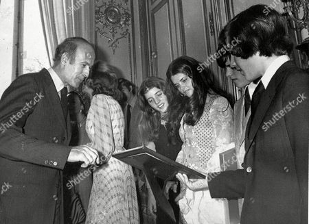 KENNEDY SHRIVER D'ESTAING French President Valery Giscard d'Estaing presents a picture of him with the late U.S. President John F. Kennedy to Caroline Kennedy, Maria Shriver, Timothy Shriver, and John F. Kennedy Jr. in Paris, . D'Estaing presented the Legion of Honor to Eunice Kennedy Shriver at ceremony earlier in the day