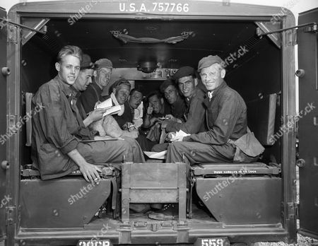 British troopers sit in the back of an ambulance at Panmunjom, to await the trip to Freedom. From left to right are: Pvt. Derrick Ackroyd of (129 The Oval), Guilstead, Bingley, Yorkshire; William Smith (no hometown available); George Smith of (14 Gaumont Dr.) Herringthorne, Rotherham.; Bob Parker (no hometown available); L/Cpl. Allan McKell of (212 Nitshill Rd.), Glasgow, S.W. 3; Rifleman Edward English of (34 Canal St.) Lisborn Co., Antin, North Ireland; Rifleman pat Morgan of Lisburn County Antrim, North Ireland; Pvt. Frank Morrell of (13 Townhead Rd.) Abroathangus, Scotland; and Felix O'Hanlon