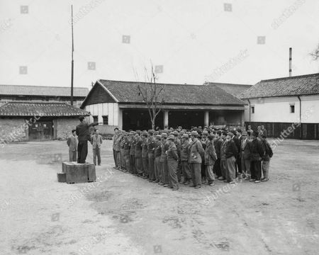 Squad of Korean National Police and Pvt. Benny S. Anderson, Roseville, Ill., from the 59th Military Police Company get acquainted before going out on a large-scale recovery raid in Taegu