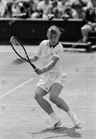 WIMBLEDON Defending champion Martina Navratilova makes a backhand return to Andrea Jaeger, during the Ladies Singles final, on Wimbledon's Centre Court . Navratilova went to defeat Jaeger 6-0; 6-3, to retain her title