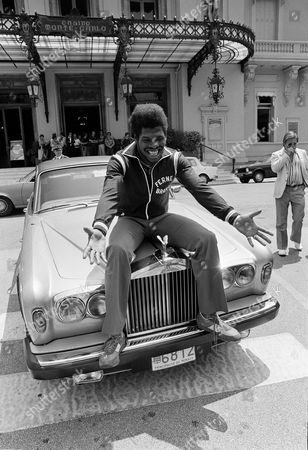 Leon Spinks Ex-heavyweight Champion Leon Spinks poses with a Rolls in Monaco