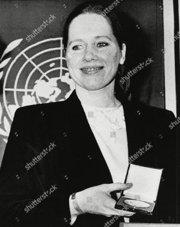 Norwegian actress Liv Ullmann smiles happily after getting the Dag Hammerskjold medal from the West German Society for the United Nations in West Berlin