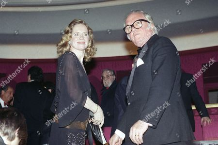 """Norwegian actress Liv Ullmann, president of the jury at the European Film Awards, and British actor Sir Richard Attenborough leave their seat at the end of the ceremony in Paris, awarding Greek director Theo Angelopoulos with the European Film of the Year Award for """"Landscape In The Mist."""" At center in background is Spanish actor Fernando Rey"""
