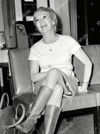 """American actress Betty Gradle, pin-up girl of the 40's, relaxes in the lounge at Heathrow Airport, London,, after she had arrived from America to star in London stage musical """"The Pieceful Palace&quot"""