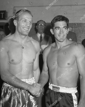 British and Empire Heavyweight boxing champion Henry Cooper, left, shakes hands with Roy Harris from Texas at Jack Solomon's gym in London, England, before their ten-round fight later that day