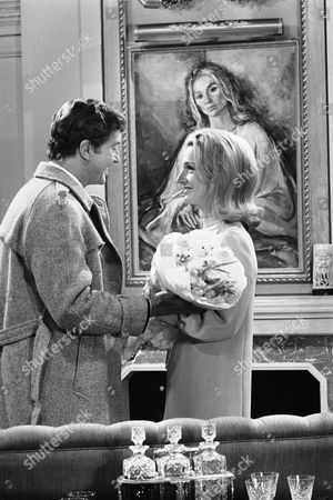 Actor Farley Granger and actress Lee Bouvier, better known as Princess Lee Radziwill, Jackie Kennedy's sister, are pictured in a scene from the new David Susskin television production Laura, being filmed in London, on . The production also stars Robert Stack and George Sanders, goes out on American television in December