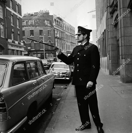 The former World Middleweight Champion of the World, Terry Downes in London,, dressed for his latest role, that of a prison warder for the play that he stars in at the Royal Court Theatre called Inside Out. Terry has the role of prison warder Manzi