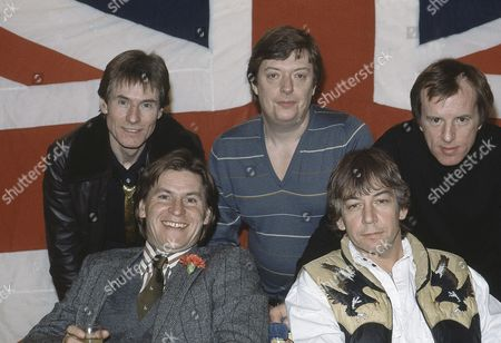 British pop group The Animals pose for photographers after they had announced plans for a world tour, in London, England, on . The tour will start in America in July 1983. From left to right back: Hilton Valentine, Chas Chandler, John Steel. Front row: Alan Price, left, and Eric Burdon