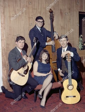 The Australian singing group 'The Seekers', pose for photographers, in London, . From left to right; Keith Potger, Athol Guy, standing, Judy Durham and Bruce Woodley