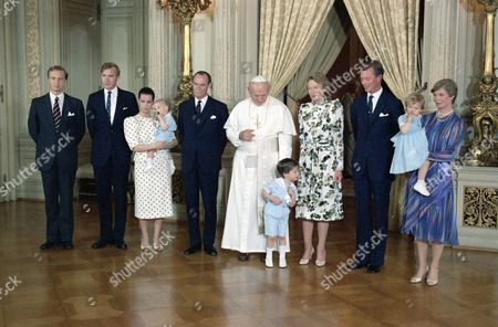 Pope John Paul II poses with Luxembourg's Royal family on at the Palace in Luxembourg. standing from left to right: Charles Christian von Habsburg-Lorraine, husband of Princess Marie-Astrid; Prince Jean, third son of the Grand Duke; Princess Maria Teresa, wife of Crown Prince Henri, holding her second son Prince Felix; Grand Duke of Luxembourg Jean; Pope John Paul II, looking down to Prince Guillaume, first son of Crown Prince Henri; Grand Duchess Charlotte; Crown Prince Henri and his sister Princess Marie-Astrid with her daughter Marie-Christine
