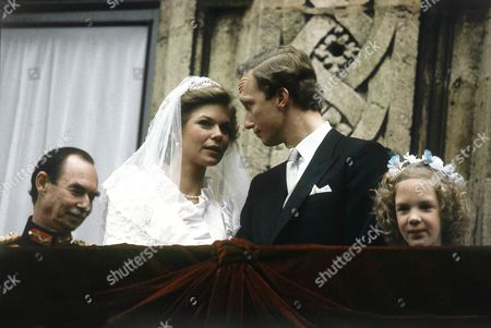 Newly weds Princess Marie-Astrid of Luxembourg, 27, and Austrian Archduke Christian von Habsburg-Lothringen (Carl Christian Marcus d'Aviano, Prince Imperial and Archduke of Austria, vonHabsburg-Lorraine), 28, on the balcony of the Grand-Ducal Castle after their wedding on in Luxembourg. At left Jean, Grand Duke of Luxembourg, the father of the bride