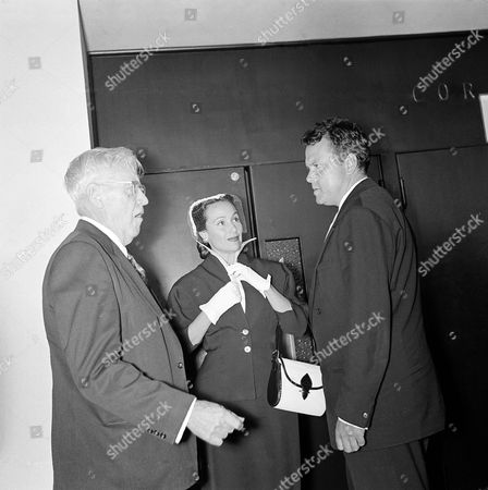 Orson Welles, Mack Sennet, Dolores del Rio From left to right, Mr. Mack Sennett, film director; American star Dolores del Rio; and the well-known Orson Welles stand talking in the Festival Palace. All three are in Cannes, on the occasion of the fifth international film festival