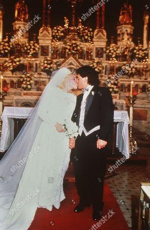 Maradona's wed - Famous soocer player from Argentina Maradona kisses his bride Claudia Villafane after their wedding ceremony