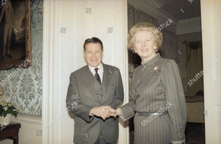 Margaret Thatcher, Caspar Weinberger British Prime Minister Margaret Thatcher is all smiles as she greets reporters with U.S. Defense Secretary Caspar W. Weinberger in London on . Weinberger announced five ?Star Wars? contracts worth $10.1 million have been awarded to Britain?s Ministry of Defense after two hours of talks with British Defense Minister George Younger