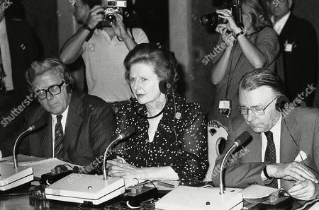 Margaret Thatcher flanked by Geoffrey Home and Francis Pym, all wearing earphones, during talks with Italian Counterparts in Rome on