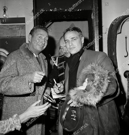 Stock Picture of Marlon Brando, Charles Trenet American actor Marlon Brando, right, meets French singer Charles Trenet during the rehearsal for the UNICEF show at the Alhambra Theater in Paris, France