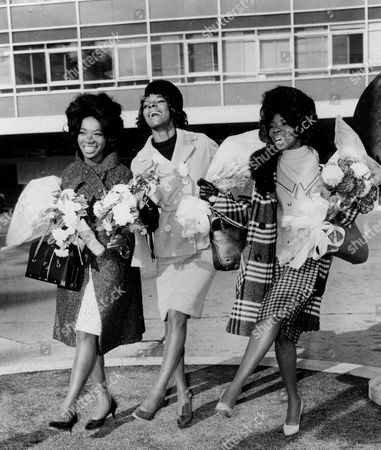 American pop trio Martha Reeves and the Vandellas are staging a dance at London Airport, as they arrive for TV appearances and recording work in the British capital. Seen from left are: Betty Kelly, Martha Reeves, and Rosalind Ashford