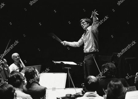 Stock Image of Maxim Shostakovich, son of the world famous Russian composer, Dmitri Shostakovich, seen during rehearsal on at the Royal Festival in London. This is Maxim's first appearance since his defection from the USSR in the summer. He will be conducting the London Philharmonic Orchestra in a programme of music by his father. This concert will commemorate the 75th anniversary of the birth of Dmitri Shostakovich