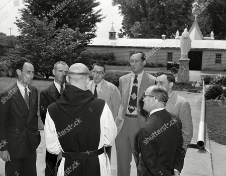 Stock Picture of Thomas Merton, Robert Lax, Robert Giroux, Edward Rice, James Laughlin, Seymour Freedgood, Daniel Walsh Thomas Merton, whose monastic name is Father Louis, greets friends from New York City, in Trappist, Kentucky, . Merton celebrated his first high Mass at Our Lady of Gethemini Abbey since his elevation to priesthood last Thursday. Regulations of the order do not permit depicting his face. His friends, from left, are: Robert Lax, writer; Robert Giroux, publication representative; Edward Rice, writer; James Laughlin, head of a publishing house; Seymour Freedgood and Daniel Walsh of Columbia University