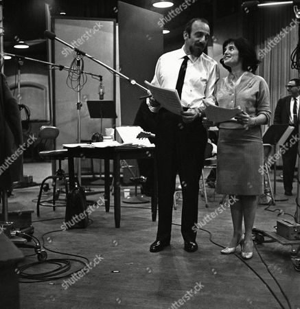 Singer Gloria Lambert is shown with Mitch Miller during recording session at Columbia Studios, New York