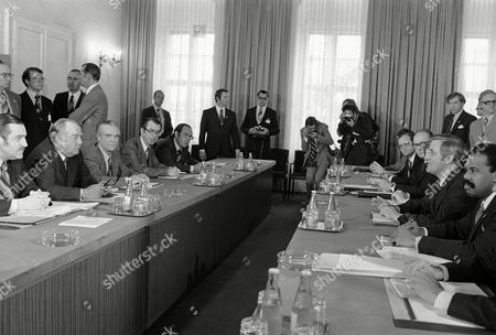 South African delegation headed by South Africa's Premier John Vorster, second from left, and the U.S. delegation, headed by U.S. Vice President Walter Mondale, third from right, face each other at the conference table in Vienna, Austria, during first round of talks. The South African delegation, from left to right: Pik Botha, foreign minister; Premier John Vorster; Brant Fourie, secretary of foreign affairs; Donald Bell Sole, ambassador to the U.S.; A. Eksteen, acting permanent representative at the U.N. The U.S. delegation is, from right: Ambassador to South Africa William Bowdler; J. Katzen, U.S. foreign service officer of the U.S. to the U.N.; James A. Johnson, executive assistant to Vice President Mondale