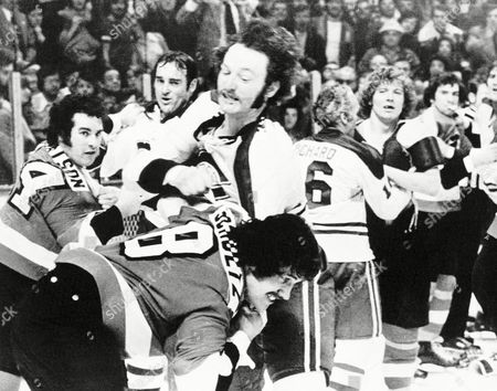 With time expired in the second period of National Hockey League game between Montreal and Philadelphia, in Montreal, bench-clearing brawl erupted in the Canadiens' end. Those involved include Montreal's Larry Robinson and Flyers' Dave Schultz (8) in foreground; Jim Watson (14) and Montreal's Frank Mahovlich, left; Henri Richard and Flyers' Bobby Clarke, right center; and Montreal's Serge Savard and Joe Watson, far right. Two Philadelphia players and one Canadien were issued game misconducts for their part in the action. The teams tied 2-0