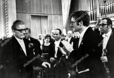 Stock Picture of Russian pianist and conductor Maxim Shostakovich, right front, greets his father Dmitri, left, after he had conducted the first performance of his fathers Fifteenth Symphony in Moscow, Russia