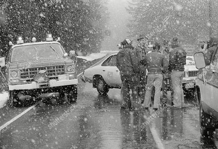 George Barker, of the Skamania County Sheriff Dept., tells residents of homes at Spirit Lake that the road was closed due to earthquakes on nearby Mount St. Helens, . The mountain has been sealed off in case it does erupt as tremors up to four on the Richter scale have been occurring in past days