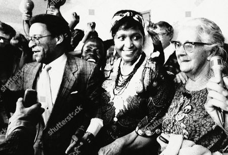 """Winnie Manela, Alan Boesak, Helen Joseph Black activist Winnie Manela, flanked by Rev. Alan Boesak (left) and Mrs. Helen Joseph, long-time campaigner for black civil rights, (right), at a press conference to launch a campaign to protect Mrs. Mandela and to stop what organizers said was harassment of """"our mother"""" on"""